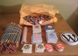 Collection of WordPress stickers, buttons, pencils - for WordCamp Boston 2010