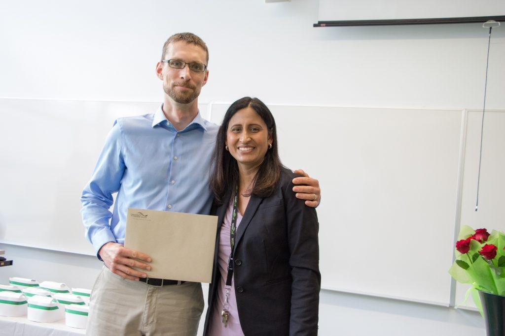 Brett Klassen Nursing graduate (left) being presented with Academic Achievement Award from Nursing faculty member Samarjit Dhillon (right).