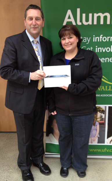 Lost Alumni campaign iPad 3 winner Natalie Karam with Alumni Association chair Tony Luck.