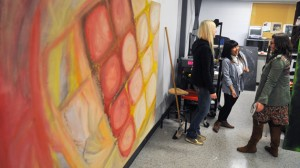 Graduating students prepare for the BFA year-end Visual Arts show.