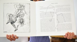 Graduating student Jenessa Galmut and her hand-made book on constellations.
