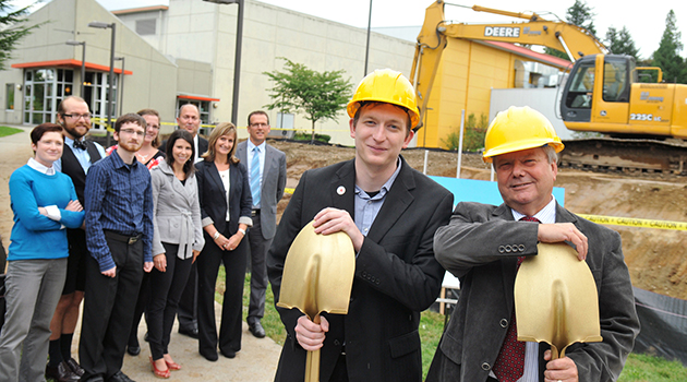 University of the Fraser Valley president Mark Evered (right) and UFV Student Union Society president Shane Potter (left) at the groundbreaking for the new Student Union Building on the Abbotsford campus. In the background are various members of the UFV administration and UFV Student Union Society executive and staff, as well as (third from right) Lyndon Fransoo, Regional Manager, Envision Financial. (Envision Financial is providing financing for the project.)