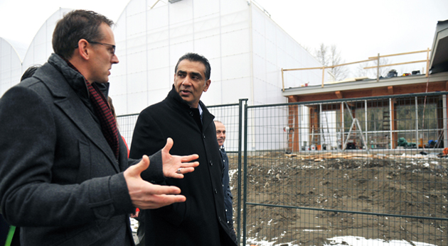 Provincial Advanced Education Minister Amrik Virk (right) tours UFV's new Agriculture Centre of Excellence with UFV executive director of campus planning Craig Toews.