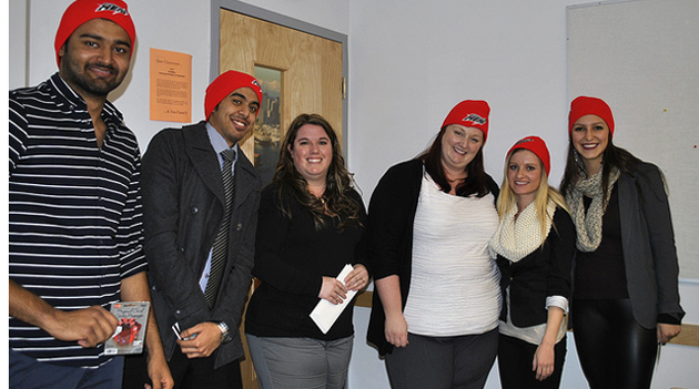 The winning team in the BUS 320 marketing presentations wearing their Abbotsford Heat red toques. They are pictured with Roxann Bury (third from left), senior manager of marketing and sales for the Heat.