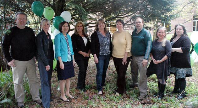 10-year employees (2014).  Left to right: Olav Lian, Lisa Gojsic, Adrienne Chan, Sue Fadden, Pauleen Nuite, Michelle Rhodes, Pat Harrison, Kim Williams, Cherish Forster.