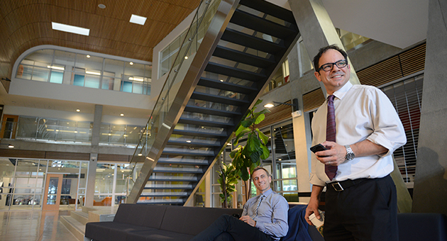 Dave Pinton (left) and Anthony Lepki of University Relations check out the atrium in the new SUB.