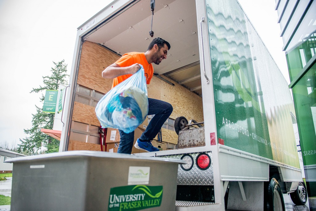 UFV student Aziz Alfadel loads donations destined for Syrian refugees settling in BC