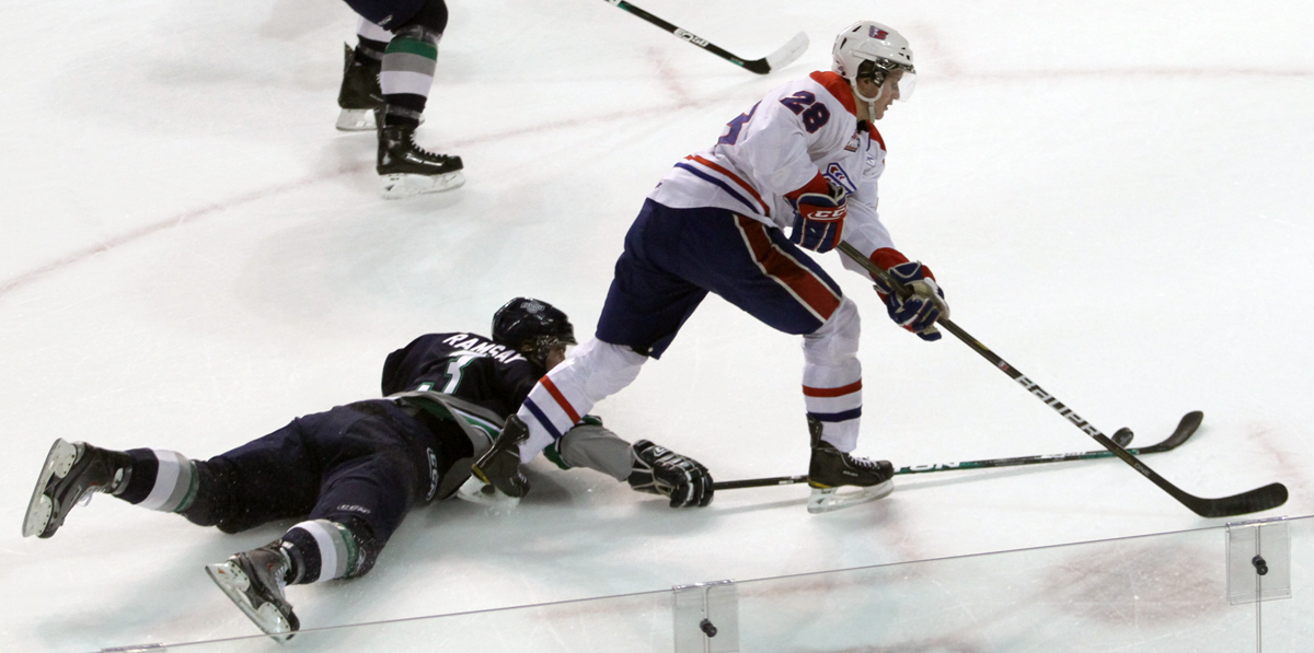 UFV Alum Scott Ramsay (in blue) deflects puck during WHL game.