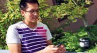 UFV student playing Pokemon GO near Marina Magnone Memorial Tree