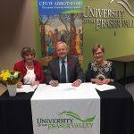 CFUW Co-Presidents Betty Tough (left) and Kate Jordon sign landmark agreement with UFV President Mark Evered