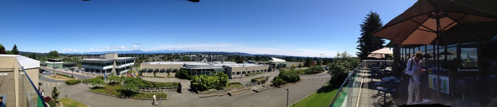 Panorama showing campus in foreground and Nanaimo, sea and mountains in background