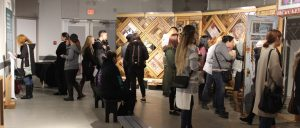 A group of students viewing the art installation called The Witness Blanket