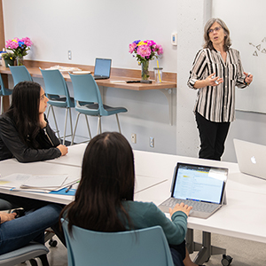 Thumbnail shows Martha Dow at a white board, speaking to the CHASI team