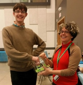 UFV Political Science student, Travis Mackenzie draws the scrabble prizes with Michelle Riedlinger