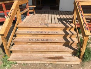 1890 Wounded Knee Remember l7th Generation lettered on stairs