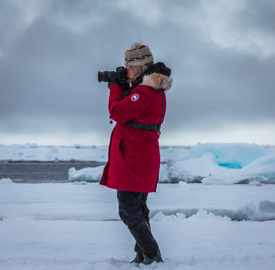 Lynne Quarmby taking photos in the Arctic. Photo courtesy Adam Laity.