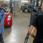 Student video host Sheetal Deo with HuStream's Jordy Starling, filming in the automotive shop at UFV's Trades and Technology Centre, Chilliwack.