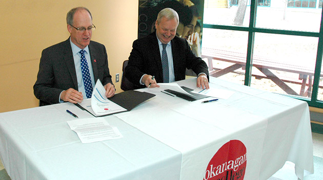 Okanagan College President Jim Hamilton and UFV President and Vice-Chancellor Dr. Mark Evered sign agreement in Salmon Arm.