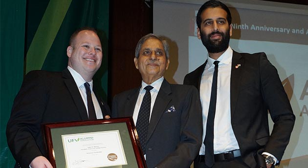 Justin P. Goodrich, Chair and Nav Bains, Associate Vice Chair of the UFV Alumni Association present Mr. Upkar Sharma, President of SD College, with lifetime honorary alumni status with the University of the Fraser Valley.