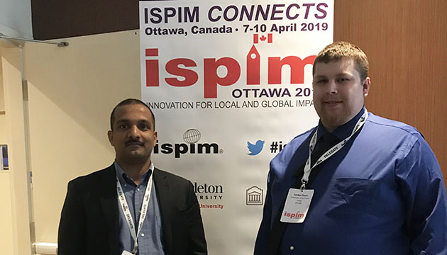 Thomas and student researcher Evans present at Innovation conference